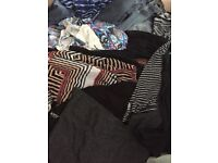 2 Clear big bag full of Women's size 10-16 clothes mainly 12