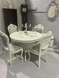 Round white dining table and 4 crushed silver chairs
