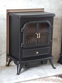 Electric fire with false decorative flame.