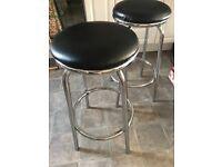 2 x black and silver bar stools