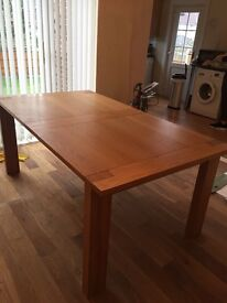 Bargain!! Immaculate practically new solid oak extendable M and S dining table