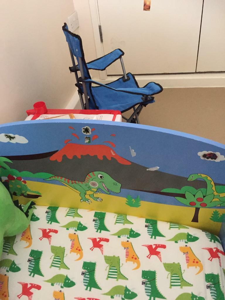 Dinosaur toddler bed with dinosaur accessories