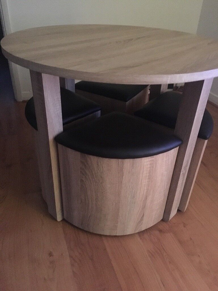 Table and chairs that fit neatly under it
