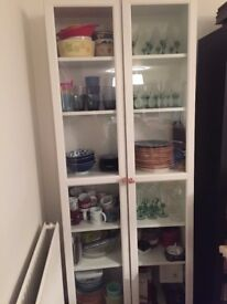 Cabinet for dishes made of 2 joined Ikea Billy bookcases with glass doors