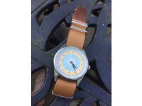 Unusual tan strap watch