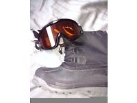Ski goggles and snow boots