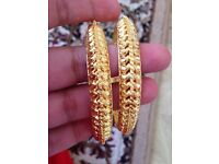 bundle of gold plated bangles