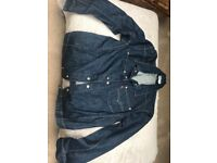 Never worn Levi's twisted denim jacket, Size M