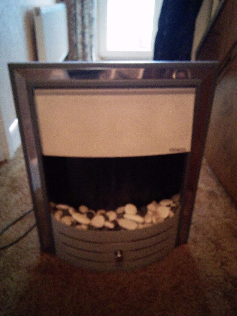 Imperial 2 kw electric fire with pebbles.imperial