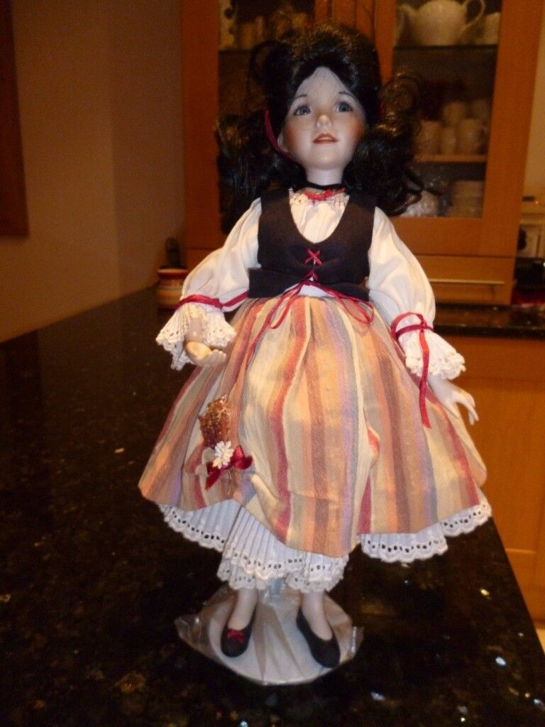 SNOW WHITE PORCELAIN DOLL ON A STAND aprox 17 in tall