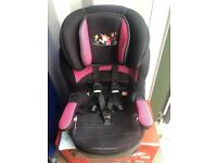 Children's car seat black with pink on highback