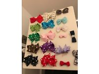 18 hair bows, a collection of different colour and sizes