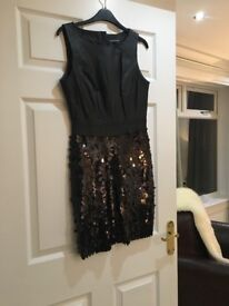 Dress size 10, never been worn. Spotlight from Warehouse clothing. Leather and sequins.