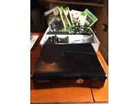 Xbox 360 slim, 1 x controller, 1 x rechargeable battery pack, 6 x games
