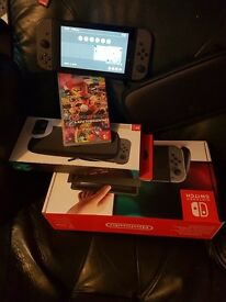 For sale a nintendo swith with two games and case like new boxed