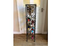 leafy wrought iron wine rack and matching candle holder