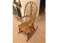 Vintage wooden rocking chair in excellent condition