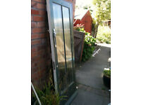Exterior wooden door with 2 ribbed glass panels