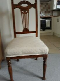 6 Dining room chairs for sale, carved backs with ivory uphostered seats.