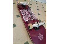 Skateboard + spare deck and a grip tape + skate tool