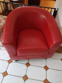 Red bucket chair fake leather seat a bit worn and slight worn on corner of arm
