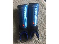 Pair of hockey shin guards - size small - 141cm-160cm