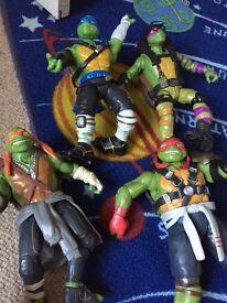 Four teenage mutant ninja turtles