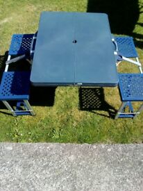 FOLDING CAMPING TABLE AND CHAIRS.