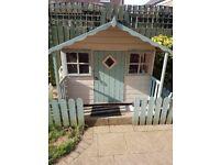 Childrens playhouse with veranda