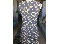 Grey dress no sleeve with yellow flowers on knee length