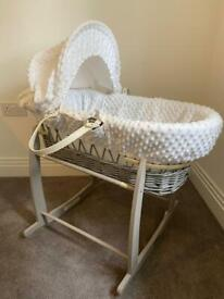 White and grey Moses basket