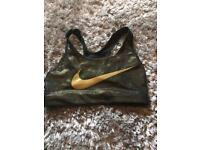 Worn once Nike, extra small, black/ gold sports bra, in vgc!