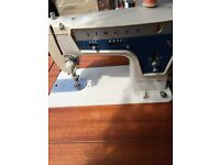 SINGER ELECTRIC SEWING MACHINE CANBE FOLDED TO TABLE IN VERY GOOD CONDITION FOR SALE