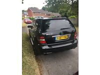 Black Mercedes ml 320cdi sport