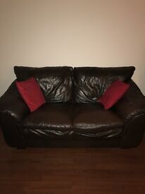 Brown leather 3 seater and 2 seater sofas and foot stool/puffy