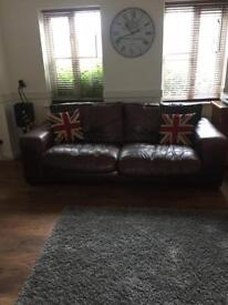 Leather brown sofas.