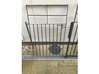 Black metal swing gate