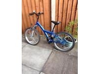 Boys blue bicycle