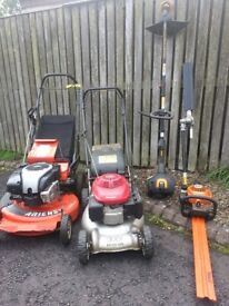 Assortment of garden machinery for sale.