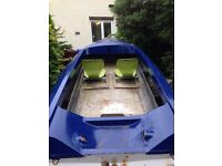 speed boat with engine and trailer