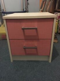 Small pink beside table with two drawers