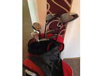 Full set of golfing clubs in original Dunlop bag