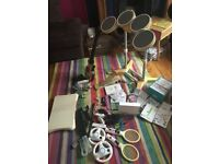 Wii console, drum set, wii fit, wii sing, wii sport, 3 handsets, 3 mics, 2 wheels,