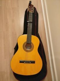 Acoustic guitar with spare strings, case, capo and digital tuner £30