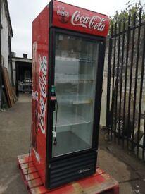 Coca cola bottle cooler display fridge.