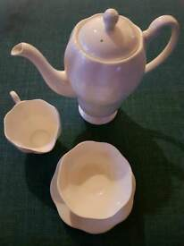 RETRO WHITE TEAPOT, MILK JUG AND SUGAR BOWL AND SAUCER.