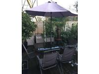 Patio table and chairs and parasol