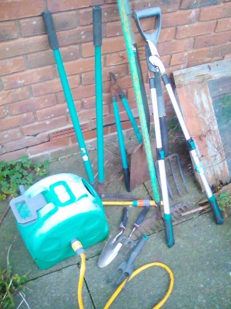 garden tools fork loppers rake hose winder etc in