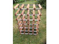 Sturdy wooden rack stores 24 bottles