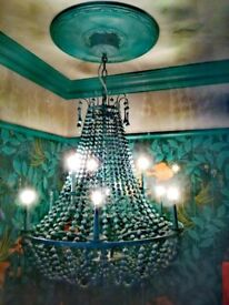 This beautiful decorative chandelier in peacock green. Price £100 It's in excellent condition.